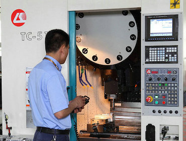 Drilling and tapping center machine